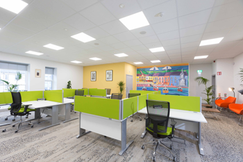 Kilrush Digital Hub hot-desks and armchairs with mural in background