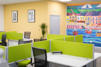 Kilrush Digital Hub hot-desks with artwork and mural in background