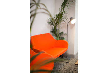 Orange armchair in the Kilrush Digital Hub with floor standing light behind it
